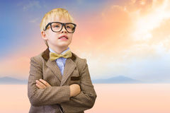 Composite image of cute pupil dressed up as teacher Stock Images
