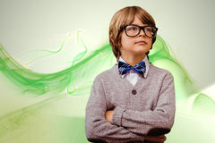 Composite image of cute pupil dressed up as teacher. Cute pupil dressed up as teacher against green abstract design Stock Photos