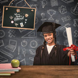Composite image of cute pupil in graduation robe Stock Images