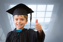Composite image of cute pupil in graduation robe Royalty Free Stock Photo