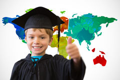Composite image of cute pupil in graduation robe Royalty Free Stock Photography