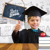 Composite image of cute pupil in graduation robe Royalty Free Stock Image