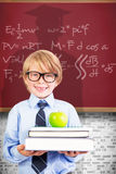 Composite image of cute pupil holding books and apple. Cute pupil holding books and apple against red background Royalty Free Stock Photos