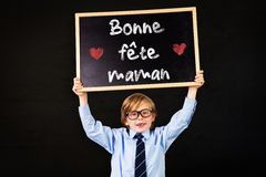Composite image of cute pupil holding chalkboard Royalty Free Stock Photography