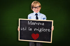 Composite image of cute pupil holding chalkboard Royalty Free Stock Photo