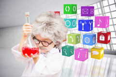 Composite image of cute pupil in lab coat Stock Images