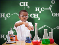 Composite image of cute pupil playing scientist Royalty Free Stock Photo