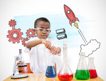 Composite image of cute pupil playing scientist Royalty Free Stock Images
