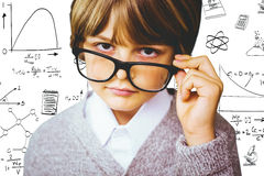 Composite image of cute pupil pretending to be teacher Royalty Free Stock Photo
