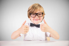 Composite image of cute pupil showing thumbs up Stock Image