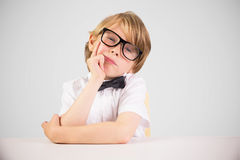 Composite image of cute pupil thinking Royalty Free Stock Photo