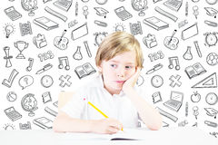 Composite image of cute pupil thinking Stock Photos