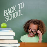 Composite image of cute pupil tilting glasses. Cute pupil tilting glasses against back to school message Stock Image