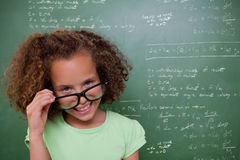 Composite image of cute pupil tilting glasses Royalty Free Stock Photos