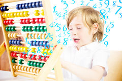 Composite image of cute pupil using abacus Royalty Free Stock Photo