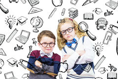 Composite image of cute pupils looking at camera. Cute pupils looking at camera against education doodles royalty free stock photos