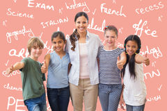 Composite image of cute pupils and teacher smiling at camera in computer class Royalty Free Stock Photos