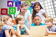 Composite image of cute pupils using tablet computer in library Stock Photo