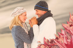 Composite image of cute smiling couple holding hands Stock Images