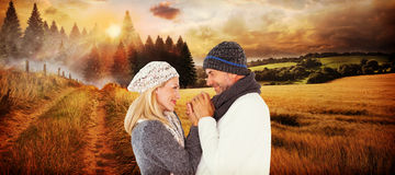 Composite image of cute smiling couple holding hands Royalty Free Stock Photos