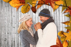 Composite image of cute smiling couple holding hands Stock Photo