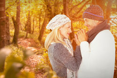 Composite image of cute smiling couple holding hands Stock Photos