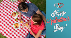Composite image of cute valentines couple Royalty Free Stock Photography