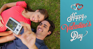 Composite image of cute valentines couple Stock Photos