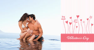 Composite image of cute valentines couple Stock Image