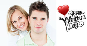 Composite image of cute valentines couple Stock Photo