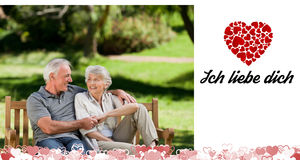 Composite image of cute valentines couple Stock Photography