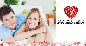 Composite image of cute valentines couple Royalty Free Stock Images