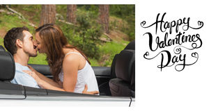 Composite image of cute valentines couple. Young couple smooching on the backseat against happy valentines day Royalty Free Stock Image