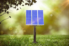 Composite image of 3d blue solar panel. 3D blue solar panel against field with glowing sky Royalty Free Stock Photography