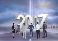 Composite image of 3D 2017 with business people on road to success Stock Image