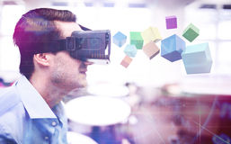 Composite image of 3d colourful cubes floating. 3d colourful cubes floating  against profile view of businessman holding virtual glasses Stock Images