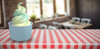 Composite image of 3d composite image of a cupcake. 3D Composite image of a cupcake against empty chairs and tables Royalty Free Stock Images