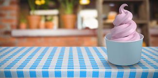 Composite image of 3d composite image of a cupcake. 3D Composite image of a cupcake against empty counter at coffee shop Royalty Free Stock Photography