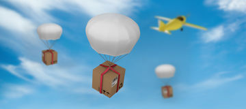 Composite image of 3d digital image of parachute carrying cardboard box Stock Image