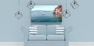 Composite image of 3d illustration of empty gray sofa with cushions. 3d illustration of empty gray sofa with cushions against idyllic view of sea Royalty Free Stock Photos
