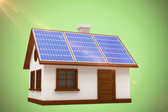 Composite image of 3d illustration of house with solar panels. 3d illustration of house with solar panels against green background Royalty Free Stock Image