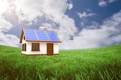 Composite image of 3d illustration of house with solar panels. 3d illustration of house with solar panels against green field under blue sky Royalty Free Stock Photo