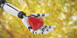 Composite image of 3d image of bionic person holding red heart shape decor. 3d image of bionic person holding red heart shape decor against branches and autumnal Royalty Free Stock Photo