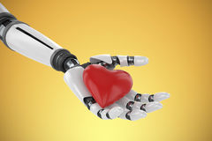 Composite image of 3d image of bionic person holding red heart shape decor. 3d image of bionic person holding red heart shape decor against yellow vignette Royalty Free Stock Image