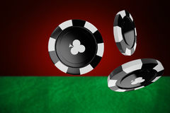 Composite image of 3d image of black casino token with clubs symbol Royalty Free Stock Images