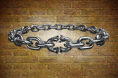 Composite image of 3d image of broken silver chain. 3d image of broken silver chain  against stone wall Royalty Free Stock Photo