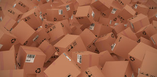 Composite image of 3d image of brown cardboard boxes. 3D image of brown cardboard boxes against factory interior Stock Images