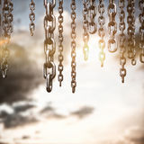 Composite image of 3d image of chains hanging Stock Photo