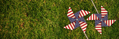 Composite image of 3d image composite of pinwheel with american flag pattern. 3D image composite of pinwheel with American flag pattern against full frame shot Stock Image