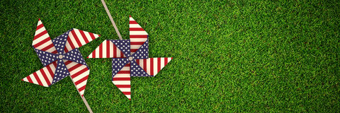 Composite image of 3d image composite of pinwheel with american flag pattern. 3D image composite of pinwheel with American flag pattern against full frame shot Royalty Free Stock Photos